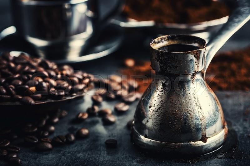 Coffee. Turkish coffee. Armenian Turkish coffee. Cezve and cup of coffee. Traditional serving coffee, stock photo