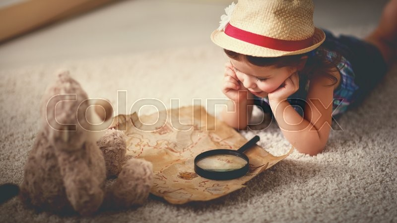 Concept travel. child girl at home dreaming of travel and tourism, exploring the world map and globe, stock photo