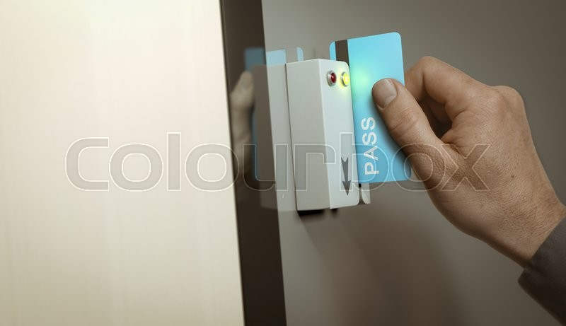 Hand With Blue Pass Card Unlocking Access To A Restricted