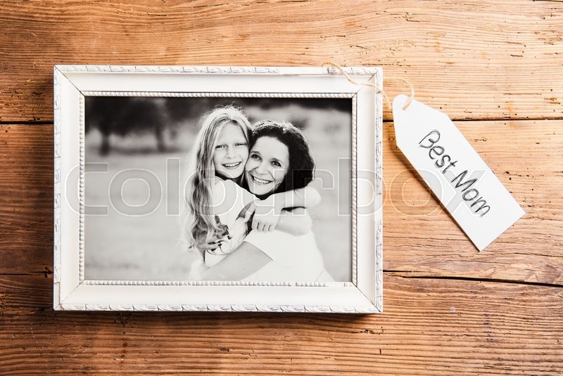 mothers day composition photo of mother and daughter in picture frame studio shot on wooden background stock photo colourbox - Mother Picture Frame