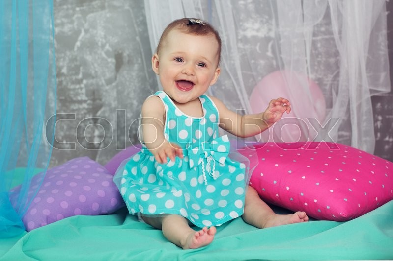 027615371 Happy cute baby girl is wearing nice ...