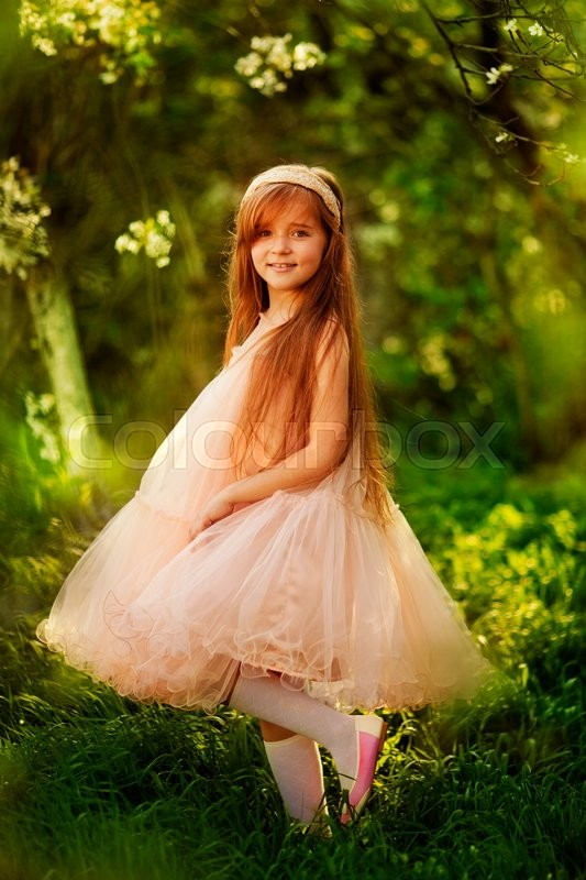 Little Girl With Long Red Hair Dancing Stock Photo