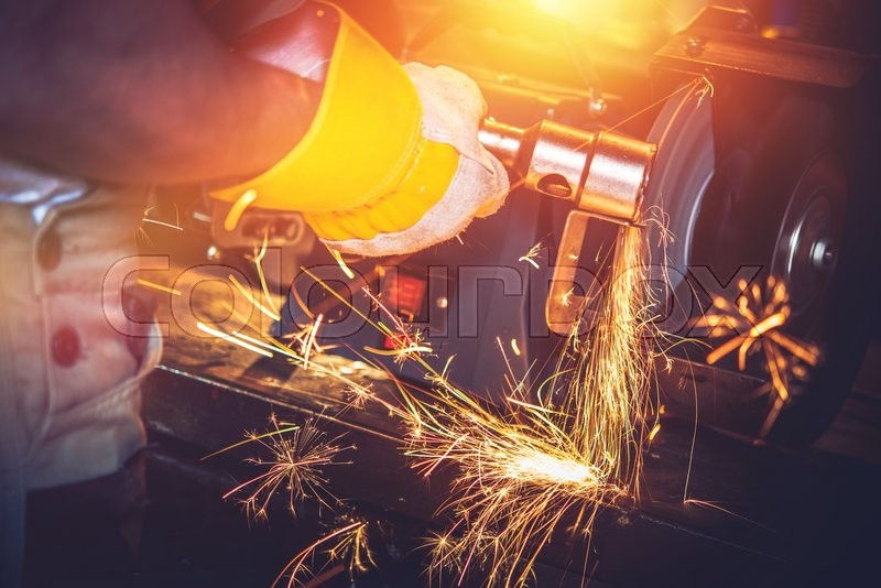 Garage Metal Works. Metal Cleaning by Heavy Duty Spinning Brush, stock photo
