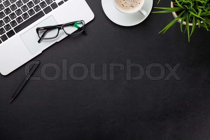Office leather desk workplace table with laptop, coffee cup and plant. Top view with copy space, stock photo