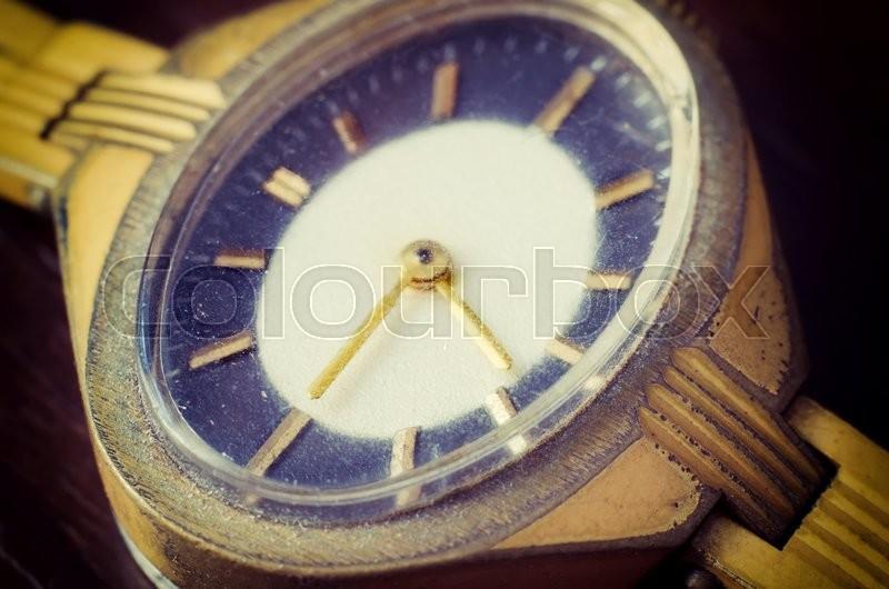 Old golden wrist watch macro, stock photo