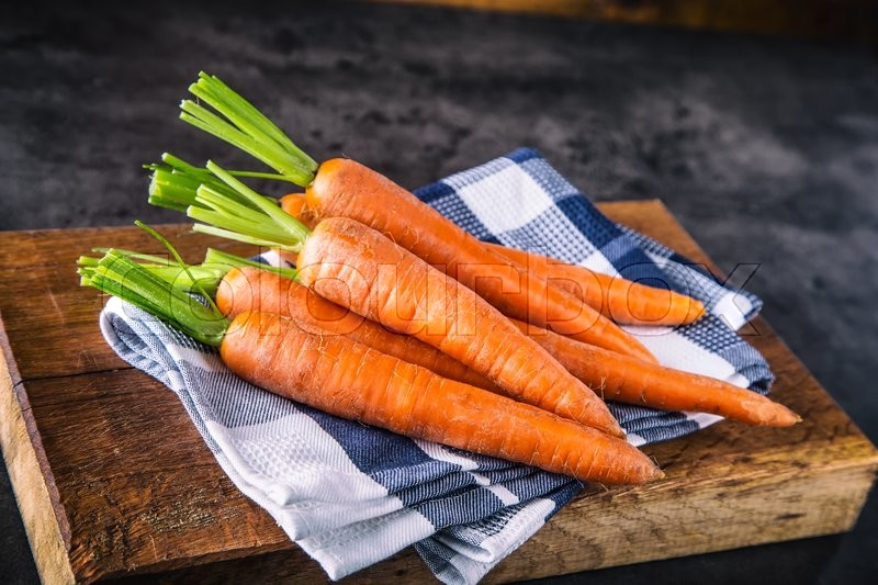 Carrot. Fresh Carrots bunch. Baby carrots. Raw fresh organic orange carrots. Healthy vegan vegetable food, stock photo