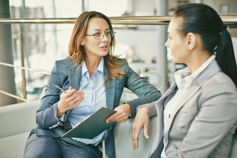 Hr manager asking questions to female candidate, stock photo