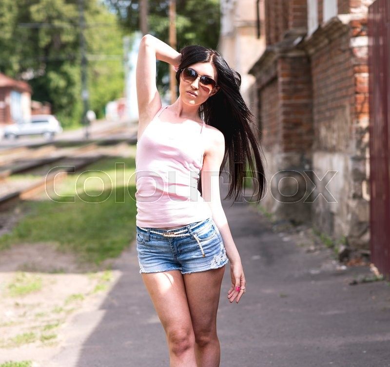 Young Beautiful Girl Posing In A Fashion City In Short