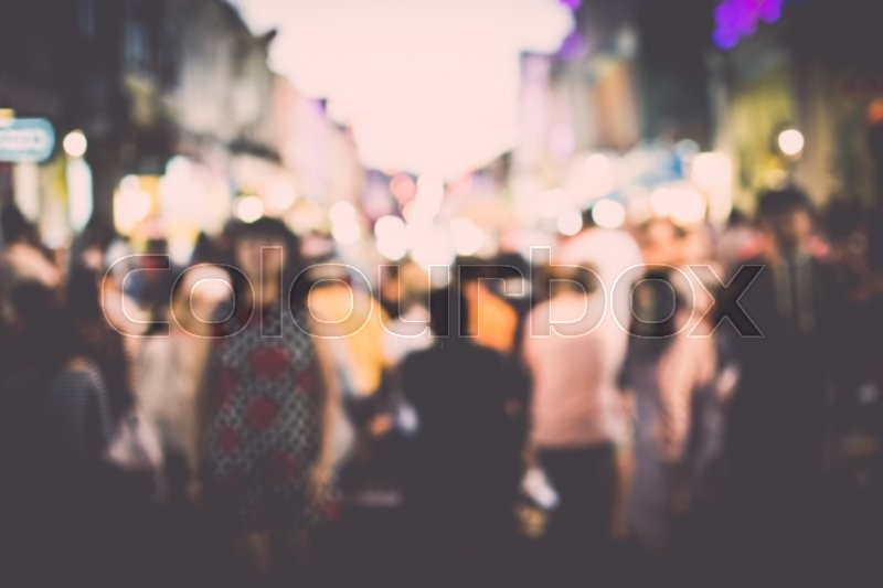 Festival event at night on the street with people blurred background, stock photo