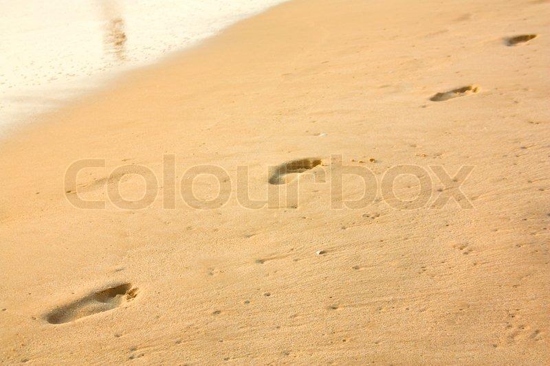 Human footprint on the beach, stock photo