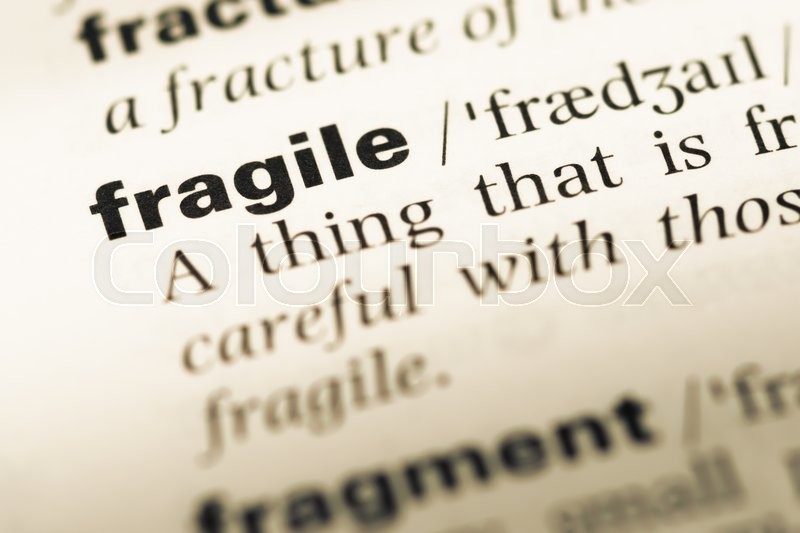 Close Up Of Old English Dictionary Page With Word Fragile, Stock Photo