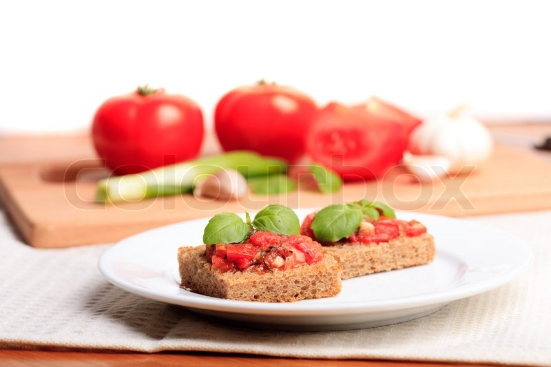 Crostini with rye bread, tomato, garlic and basil. National italian ...