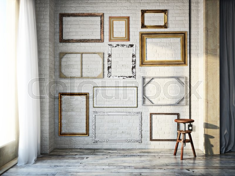 Abstract interior of assorted classic empty picture frames against a ...