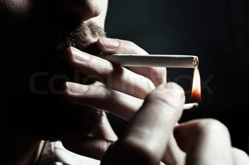 Menu0027s hand lights a cigarette with a match closeup | Stock Photo | Colourbox & Menu0027s hand lights a cigarette with a match closeup | Stock Photo ... azcodes.com