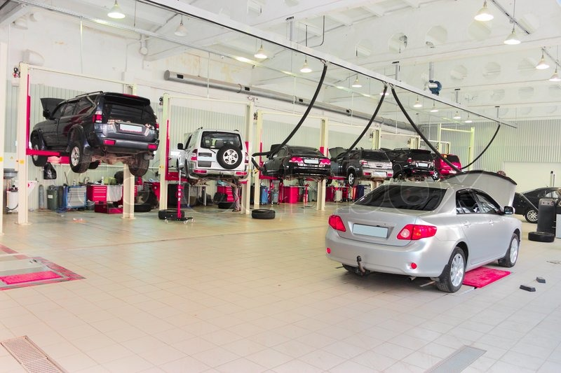 The car on the lift in a repair garage stock photo for Garage fix auto nimes