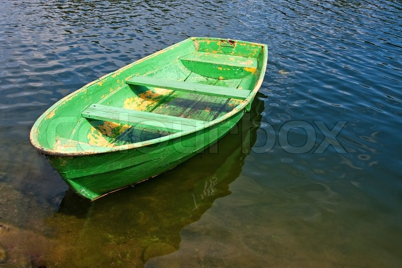 Old green rowing boat on a lake | Stock Photo | Colourbox