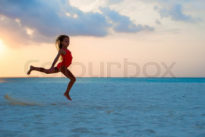 Cute little girl lying in sand on the    Stock image