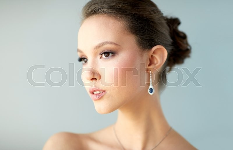 Stock image of 'beauty, jewelry, wedding accessories, people and luxury concept - close up of beautiful asian woman or bride with earring'