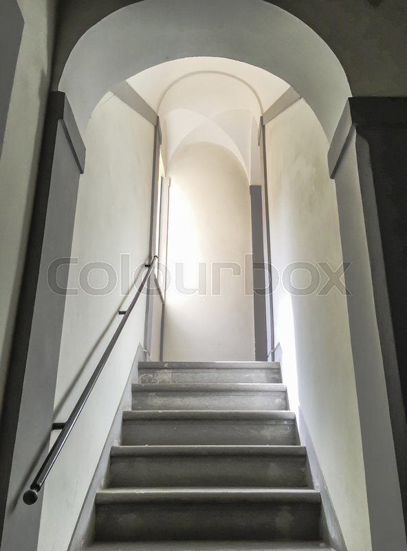 Stock image of 'ancient stairway with sunlight on the left'