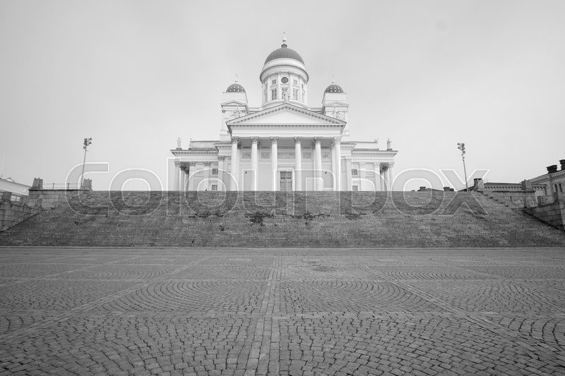 Stock image of 'HELSINKI, FINLAND - april, 4, 2016: St. Nicholas Church and a monument of Alexander II on the Senatorial area in Helsinki, Finland.'