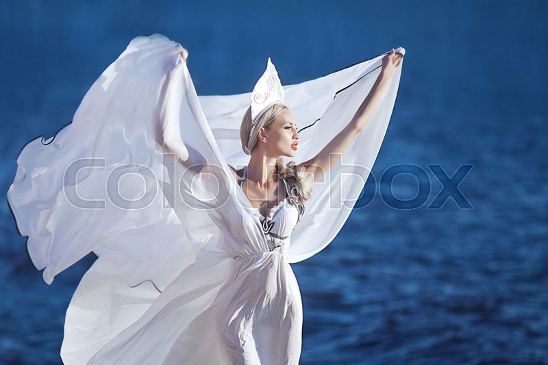 Stock image of 'beautiful girl with wings on the beach'