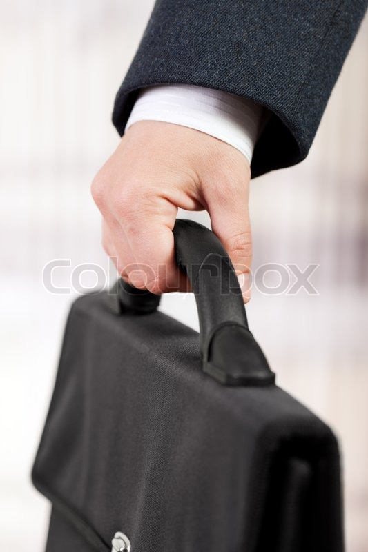 Technology Management Image: Business Men In Black Suit Hand Holding Briefcase