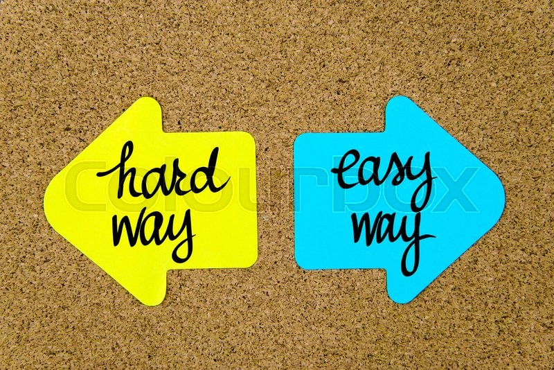 Stock image of 'Message Hard Way versus Easy Way on yellow and blue paper notes as opposite arrows pinned on cork board with thumbtacks. Choice conceptual image'