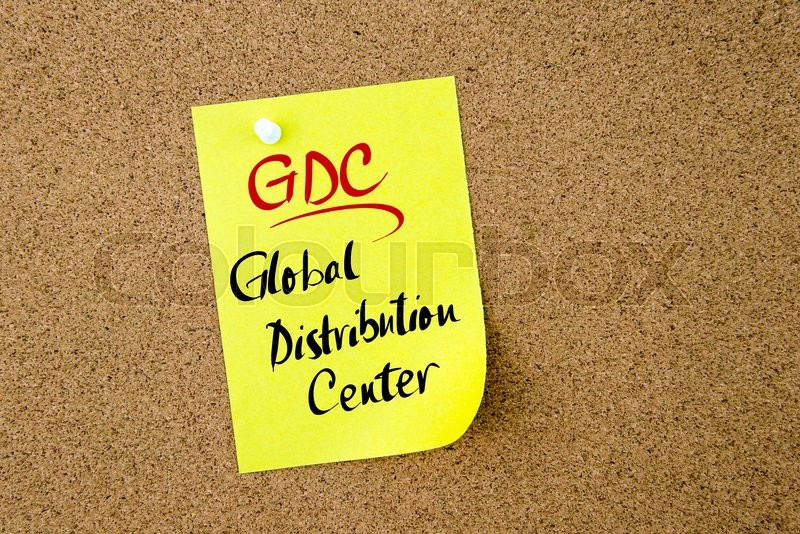 Stock image of 'Business Acronym GDC Global Distribution Center written on  yellow paper note pinned on cork board with white thumbtack, copy space available'