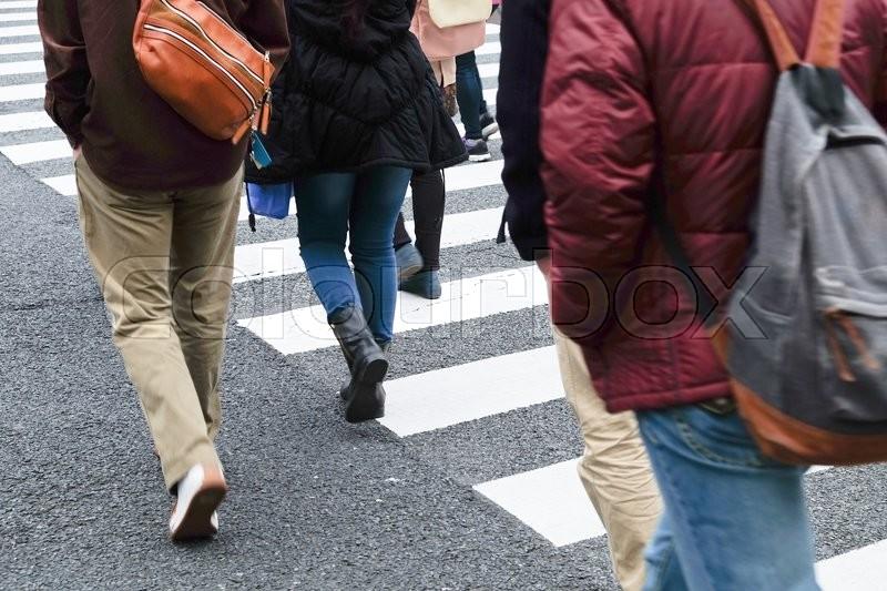 Crowd of people crossing at Ueno Hirokoji intersection, Tokyo Japan, stock photo