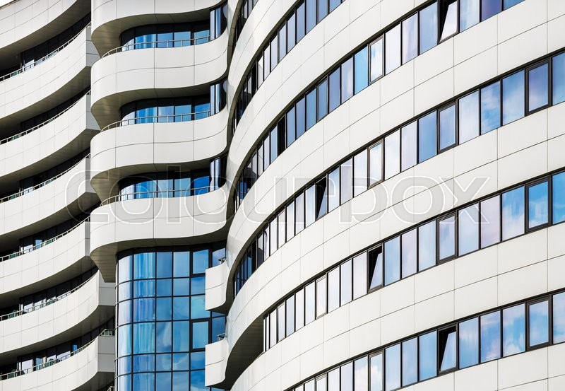Abstract modern architecture. Modern building of steel and glass. Harmonious combination of smooth lines of modern architecture, stock photo