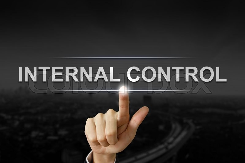 Business Hand Clicking Internal Control Button On Black