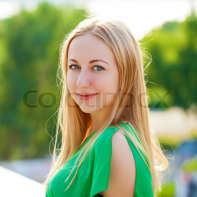 Stock image of 'Close up Portrait, Young beautiful blonde woman posing outdoors in sunny weather'