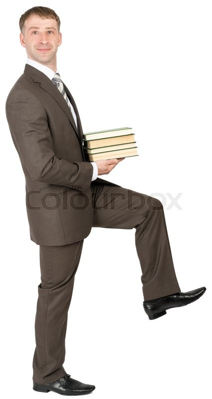 Stock image of 'Businessman holding books and looking at camera isolated on white background'