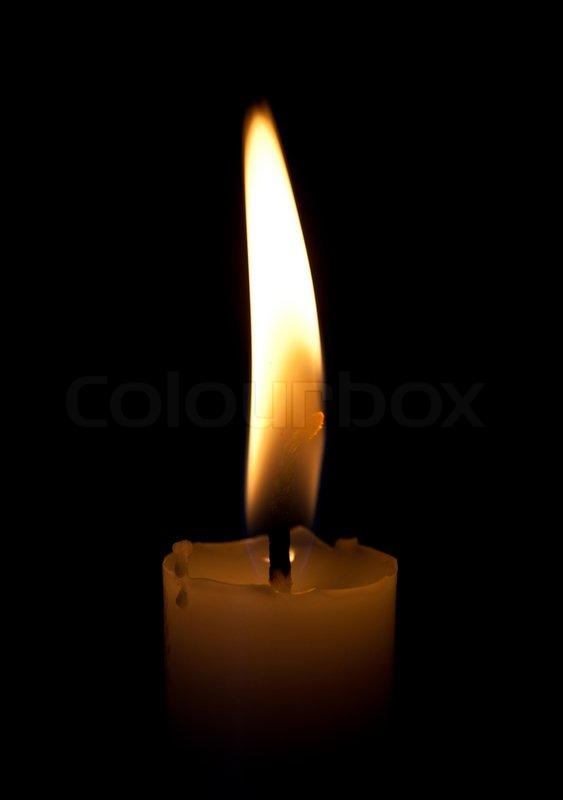 brennende kerze auf schwarzem hintergrund stockfoto colourbox. Black Bedroom Furniture Sets. Home Design Ideas