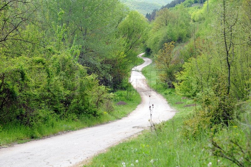 Long winding dirt road in the Balkan Mountains in Bulgaria ...
