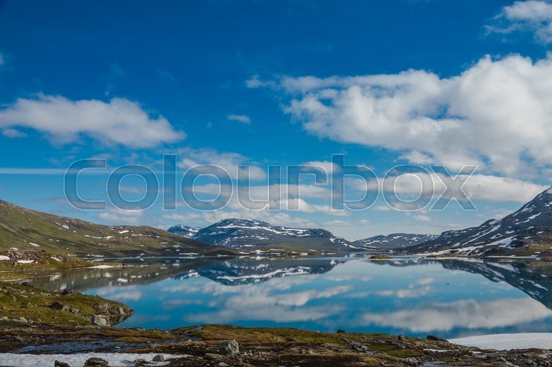Stock image of 'Mountains reflecting in a crystal clear lake'