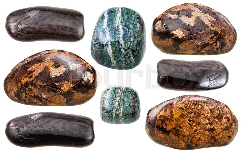 Stock image of 'set of various Enstatite (bronzite, green and brown hypersthene) natural mineral stones and gemstones isolated on white background'