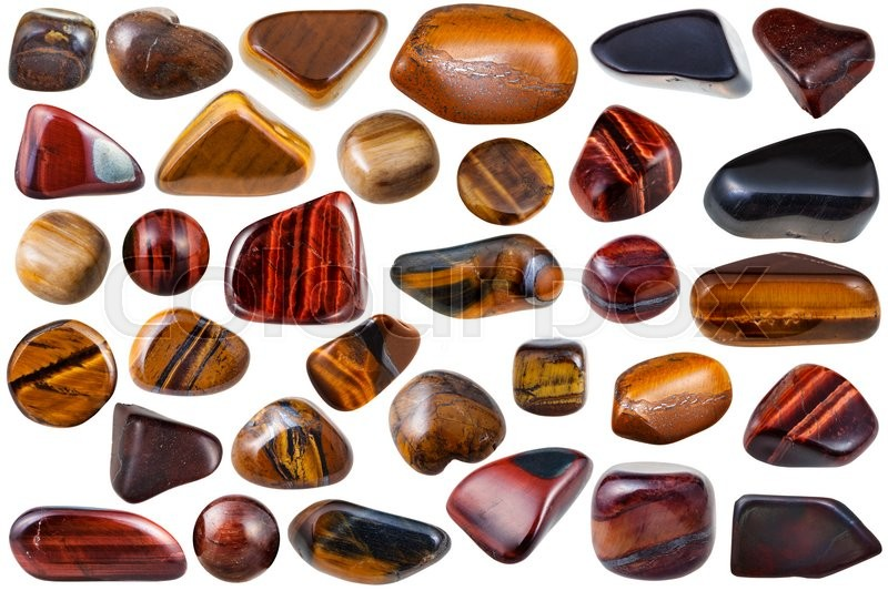 Stock image of 'set of various tiger-eye natural mineral stones and gemstones (tigers eye, bull-eye, hawk-eye) isolated on white background'