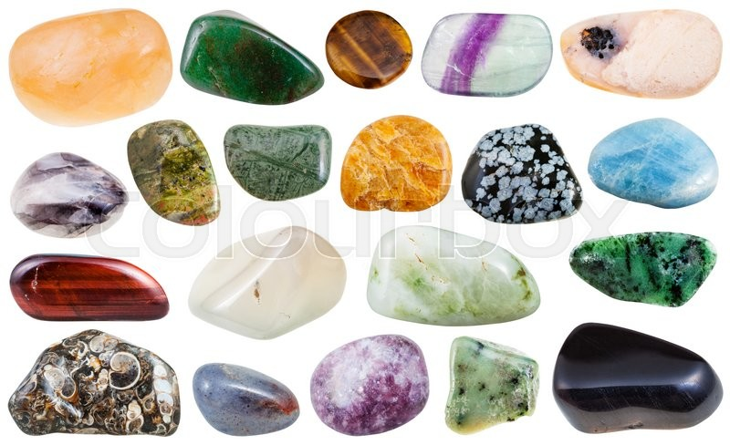 Stock image of 'set of various polished natural mineral stones and gemstones - clinohumite, zoisite, snowflake obsidian, unakite, iolite, aventurine, fluorite, aquamarine, beryl etc isolated on white background'