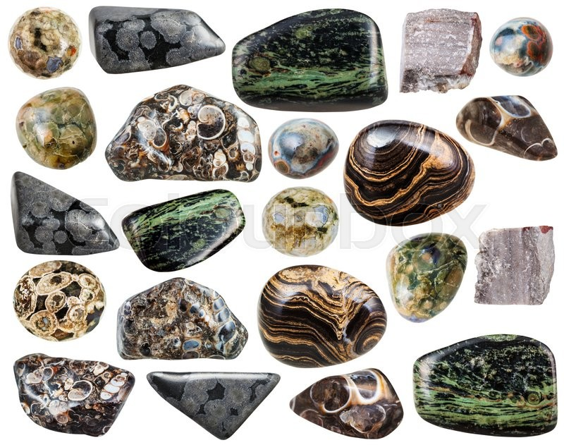 Stock image of 'set of various natural rhyolite mineral stones and gemstones isolated on white background'