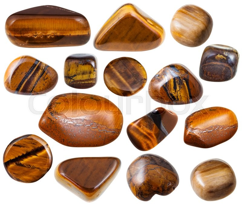 Stock image of 'set of tigers eye (tiger-eye, tigereye, tigers-eye) mineral stones and gemstones isolated on white background'
