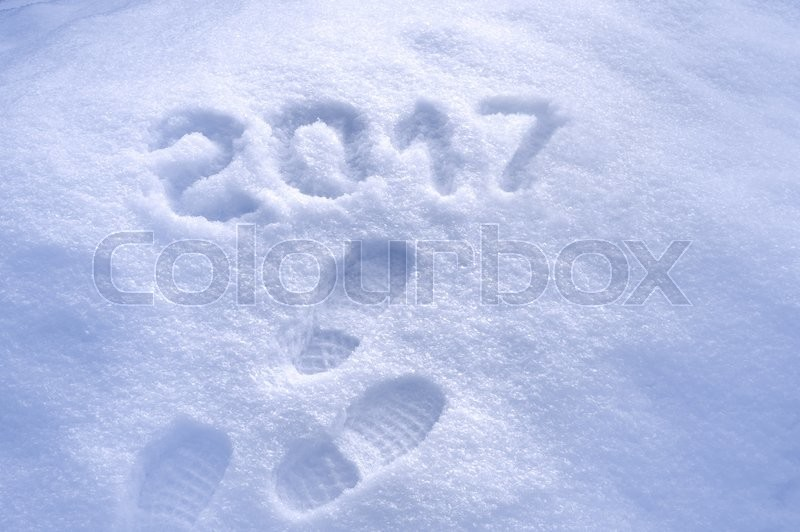 Stock image of 'New Year 2017 greeting, footprints in snow, new year 2017, 2017 greeting card'