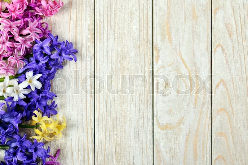Stock image of 'bouquet of hyacinths on a white table with boards'