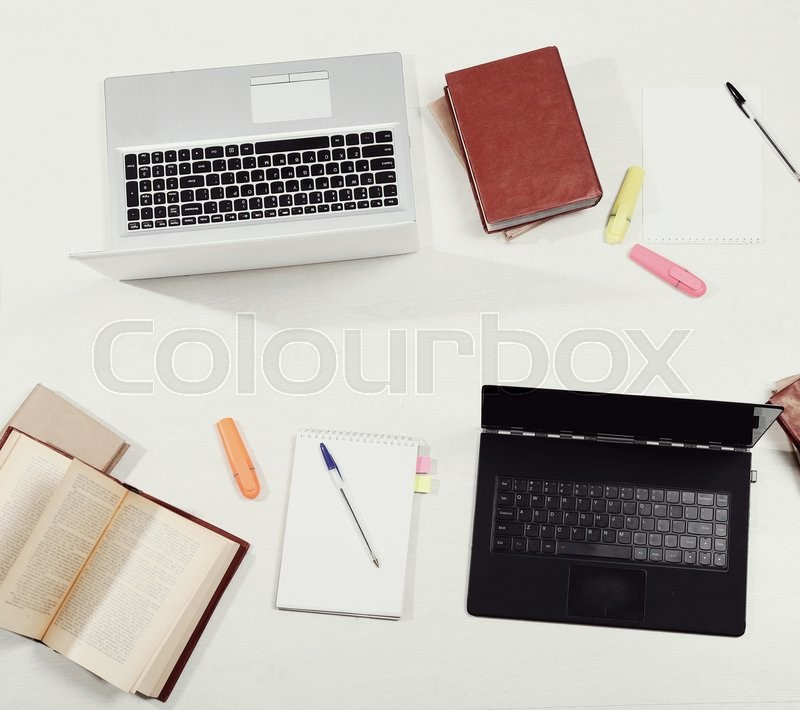 Stock image of 'Workplace. Office table from top view'