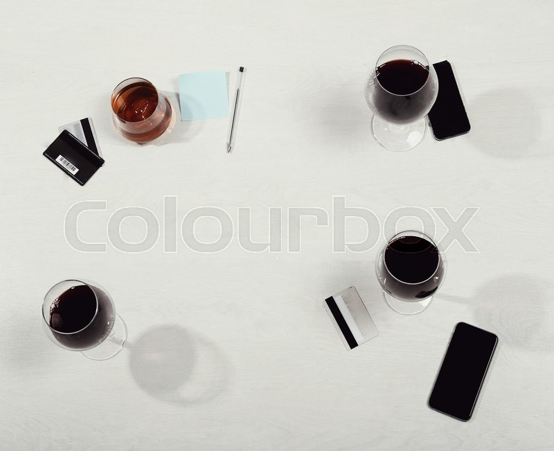 Stock image of 'Gathering of friends by the table'