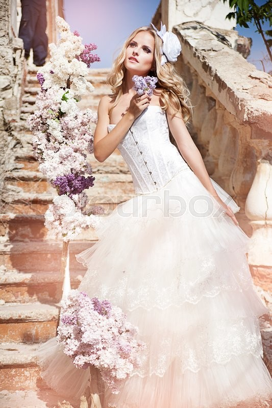 Stock image of 'picture of young woman wearing wreath of flowers'