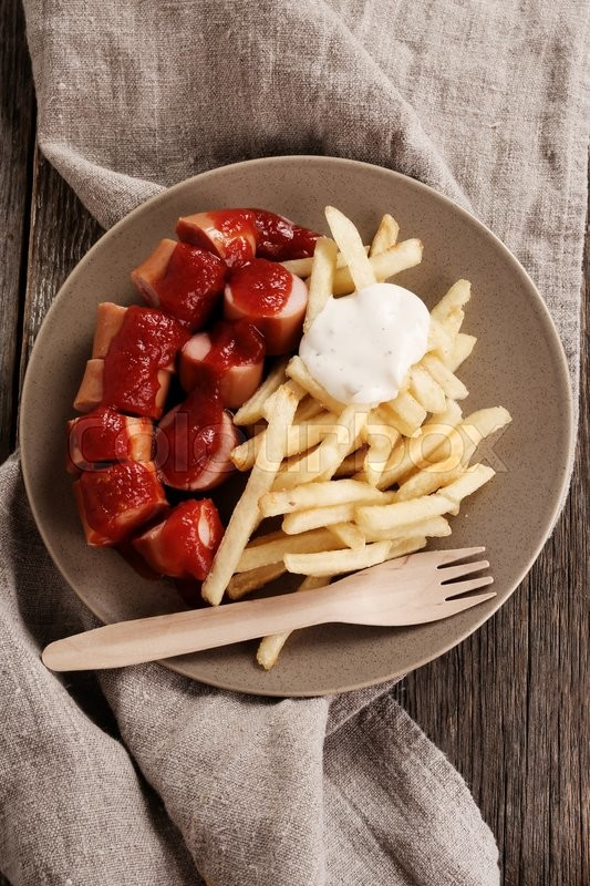 Stock image of 'Curry wurst with french fries'