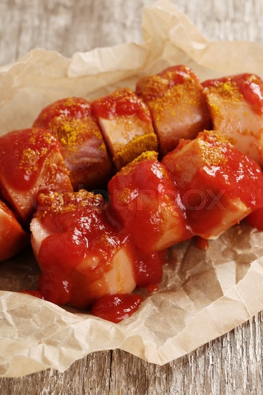 Stock image of 'Food. Curry wurst with ketchup'
