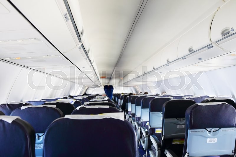 Stock image of 'Inside airplane cabine back view, close up'