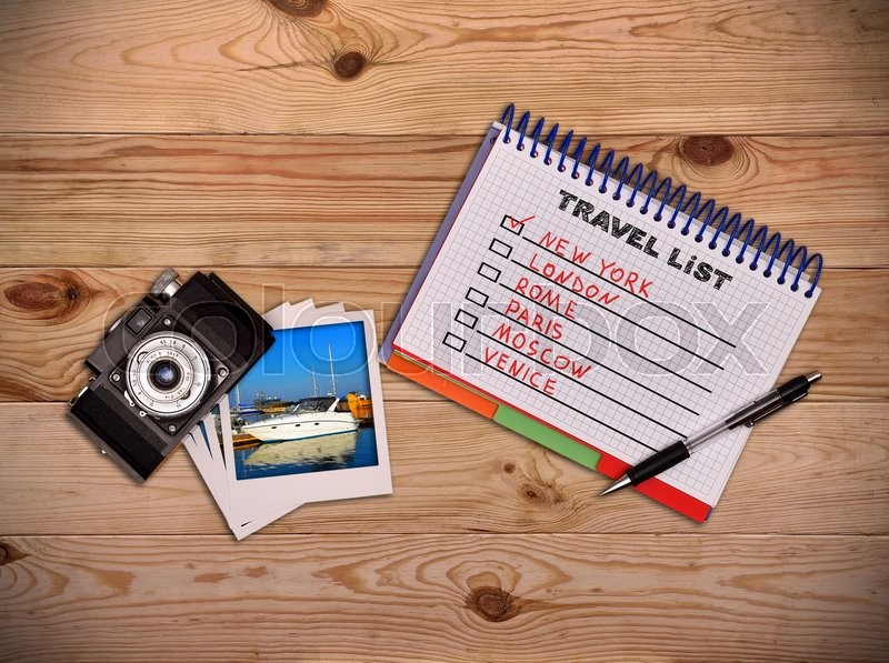 Stock image of 'Camera, photo and notepad with drawing travel list. Work desk tourist.'